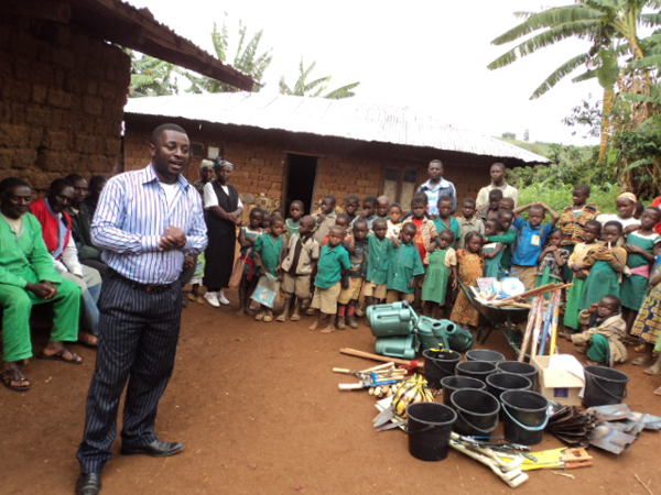 Emmanuel Wirsiy during donation of craftwork and farm tools to Cameroon Baptist Convention (CBC) Kisotin-Oku Cameroon.