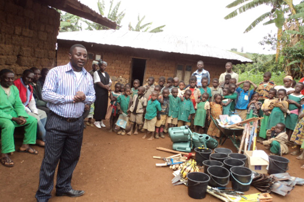 Emmanuel Wirsiy, during a donation drive of craftwork and farm tools to Cameroon Baptist Convention (CBC) Kisotin-Oku Cameroon.