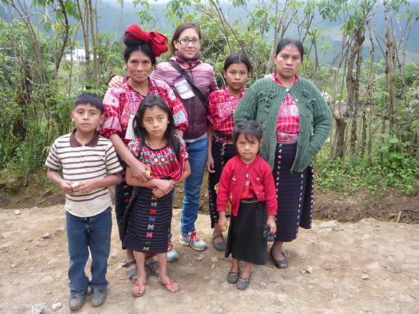 Isis Alvarez, with indigenous women and children from Guatemala during a Mesoamerican Peoples Summit in Yalambojoch, 2010.