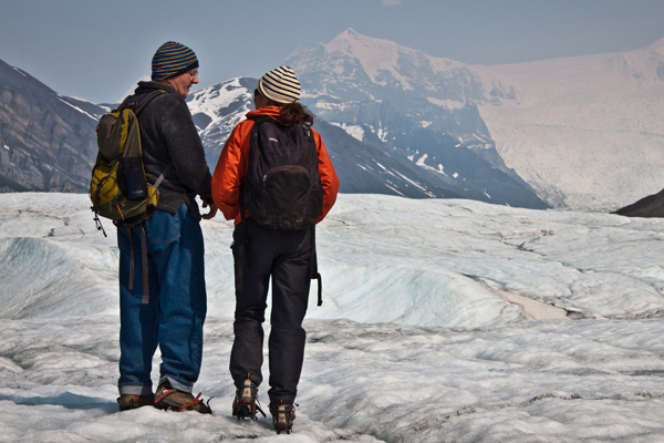 Margot Higgins, interviewing an 82 year old park resident while hiking on the glacier during her research in Alaska's Wrangell-St. Elias Park.