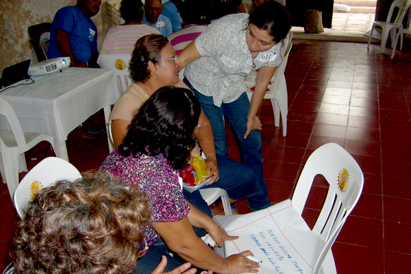 Women empowerment and their inclusion in the decision-making processes was an important part of Yolanda Lopez's research. Here, a group of women are dealing with pollution problems in their community.