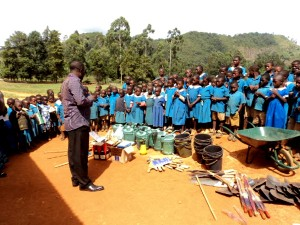 Farm and handiwork tools and materials handed to GS Simonkoh, Oku.
