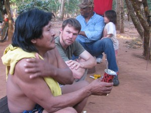 Listening to the leader of an indigenous community in southeast Paraguay during a meeting with a team from the Inter-American Development Bank that was investigating a land claim made by the community.