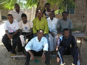 A picture I (arrowed) took with Environmental Volunteers in the Krisan Refugee Camp after a training session.