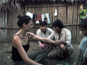 Being painted by Tsimane' women while carrying out fieldwork in Beni, Bolivian Amazonia.
