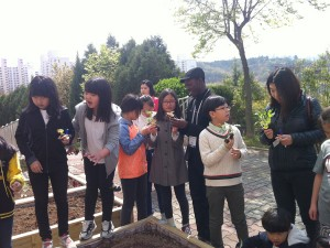 Gardening and tree planting with children of Hopesoil Farming School during the Be a Green Man campaign, 15 April 2015, in Daegu, South Korea.